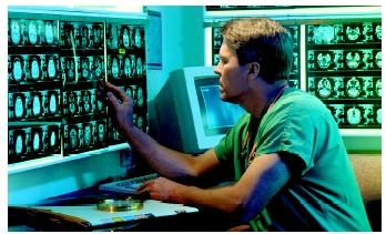 A surgeon reviewing CAT scans.